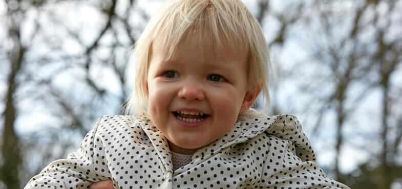 toddler smiling park