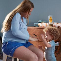 Mother and child using Johnson's® Baby Oi